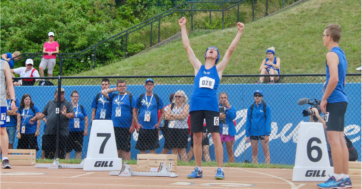 A Special Olympics athlete cheers at National Games.