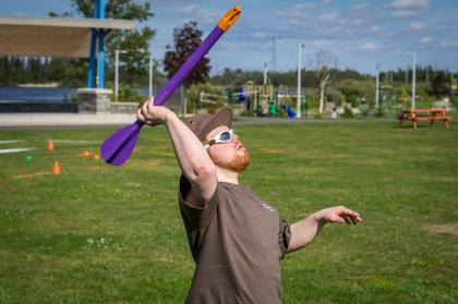 Athlete throwing mini javelin