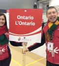 SOO's Juli Prokopchuk-Brattan and athlete Stephen Graham hold a sign that reads Ontario.