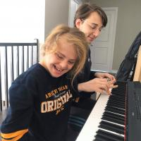 Emran and Aliaa Alnahhas play the piano together.