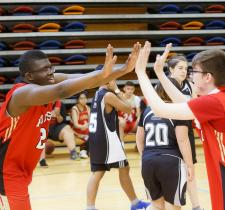 Athletes high five at a ASAA Unifed Sport event