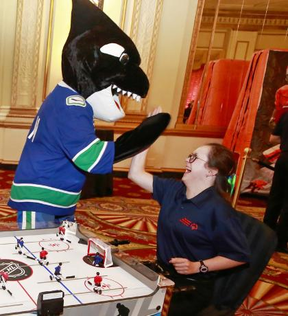 FIN gives SOBC – Abbotsford athlete Paige Norton a high-five at the 2019 SCF. Photo by Jeff Vinnick courtesy of the Vancouver Canucks.