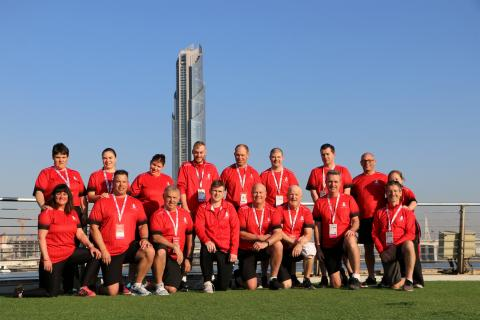 Misty Pagliaro (bottom left) soaking up the sun in Abu Dhabi with the Team Canada golf team at the 2019 Special Olympics World Summer Games.
